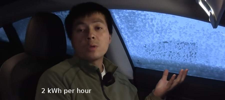 Tesla Model 3 camping in snow storm
